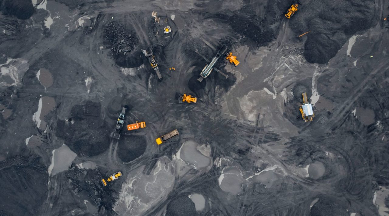 Coal mining an open pit extractive industry, top view aerial.